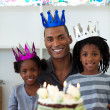 Stock Photo: Joyful Afro-american father with his children celebrating a birt