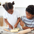 Stock Photo: Concentrated brother and sister cooking biscuits