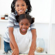 Adorable brother and sister cooking biscuits — Stock Photo #10293218