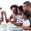 Afro-American family working with a computer at home - Stock Photo