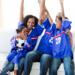 Excited Afro-American family celebrating a football goal — Stock Photo