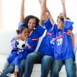Excited Afro-American family celebrating a football goal — Stock Photo #10293228