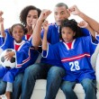 Photo: Excited Afro-American family watching a football match