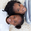 Portrait of Afro-American brother and sister on floor - Foto de Stock  