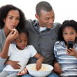 Afro-American family watching a film at home — Stock Photo #10293255