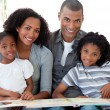Portrait of an Afro-American family reading a book in the living — Stock Photo