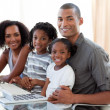 Happy Afro-American family working with a computer at home — ストック写真