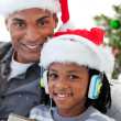 Portrait of an Afro-American father and son at Christmas time — Stock Photo