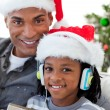 Portrait of an Afro-American father and son at Christmas time - Stok fotoğraf