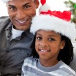 Portrait of an Afro-American father and son holding a Christmas - Stok fotoğraf