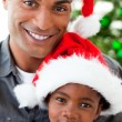 Portrait of a smiling father and daughter at Christmas time - Stockfoto