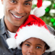 Portrait of a smiling father and daughter at Christmas time - Foto Stock