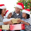 Afro-American family celebrating Christmas at home — Stock Photo