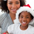 Royalty-Free Stock Photo: Portrait of a mother and a daughter wearing a Christmas hat