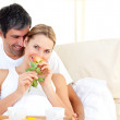 Close-up of couple having breakfast lying in the bed — Stock Photo