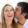 Close-up of man kissing his girlfriend — Stock Photo