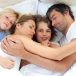 Stock Photo: Adorable family relaxing together