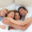 Stock Photo: Animated family hugging in bedroom