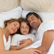 Cute child and his parents sleeping together — Stock Photo #10293386