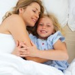 Adorable child hugging with her mother — Stock Photo