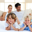 Cute siblings listening music with headphones — Stock Photo