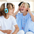 Joyful children having fun and listening music — Stock Photo