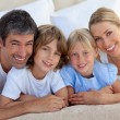 Stock Photo: Merry family having fun in the bedroom