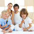 Stock Photo: Animated family singing together