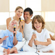 Happy family singing together — Stock Photo