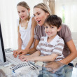Smiling little boy at a computer — Stock Photo