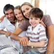 Portrait of a smiling family at a computer — Stock Photo
