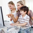Royalty-Free Stock Photo: Children and their mother using a computer