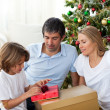 Cheerful family celebrating Christmas - Stockfoto