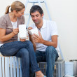 Lovers relaxing while renovating their new house - Stockfoto