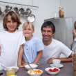 Smiling family having breakfast — Stock Photo #10293511