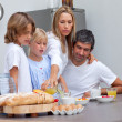 Loving family having breakfast — Stock Photo #10293516