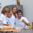 Joyful family having breakfast — Stock Photo #10293518