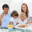 Stock Photo: Positive family eating pizzas