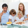 Positive family eating pizzas - Stock Photo