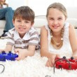 Cute brother and sister playing video games - Stockfoto