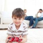 Постер, плакат: Adorable little boy playing video games