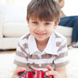 Close-up of little boy playing video games — Stockfoto