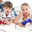 Stock Photo: Animated children playing video games