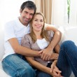 Stock Photo: Happy couple relaxing on the sofa