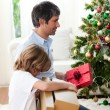 Royalty-Free Stock Photo: Father and his son opening Christmas gifts