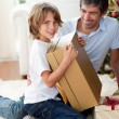 Happy Father and his son opening Christmas gifts — Stock Photo #10293573