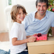 Smiling father and his son opening Christmas presents — Stock Photo