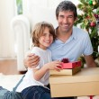 Father and his son holding Christmas gifts — Foto Stock