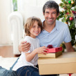 Father and his son holding Christmas gifts — Foto de Stock