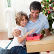 Happy father and his son holding Christmas presents — Stock Photo